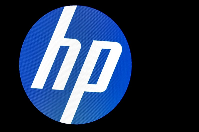 A screen displays the logo for HP Inc. at the NYSE in New York