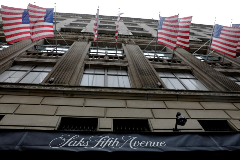 FILE PHOTO: U.S. flags fly outside of Saks Fifth Avenue in New York