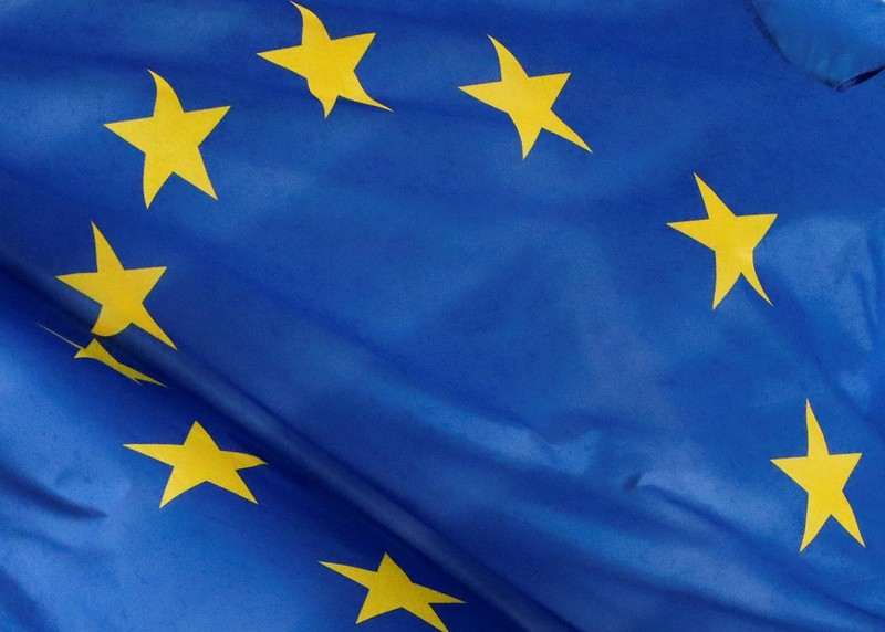 A European flag is seen outside the EU Commission headquarters in Brussels