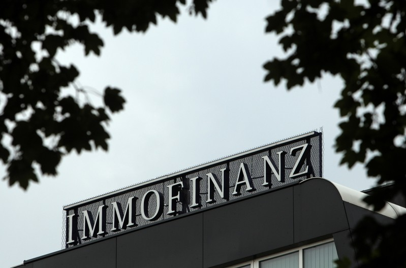 The logo of Austrian real estate group Immofinanz is pictured on top of the company's headquarters building in Vienna