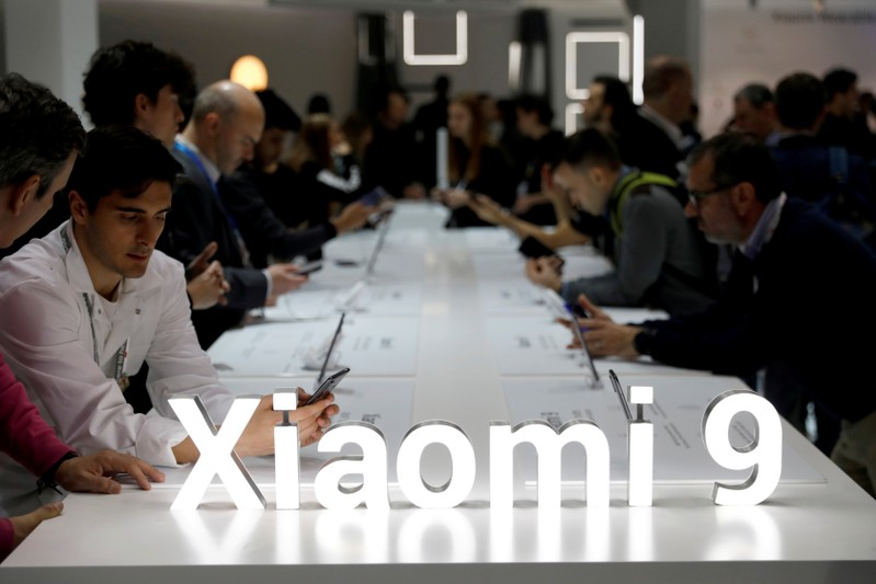 FILE PHOTO: Visitors visit the Xiaomi booth at the Mobile World Congress in Barcelona