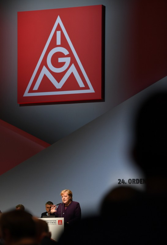 German Chancellor Angela Merkel speaks to delegates of Germany's largest industrial union IG Metall during the trade union congress in Nuremberg