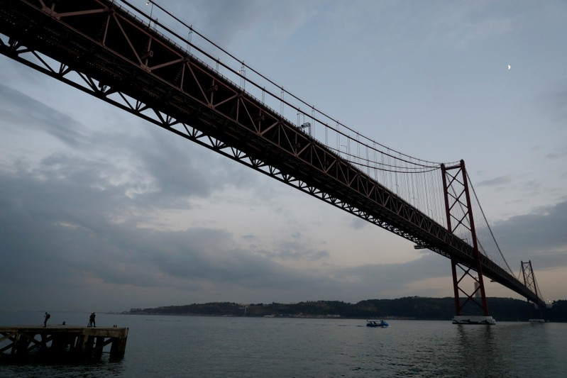 View of the 25th April Bridge over the Tagus river in Lisbon