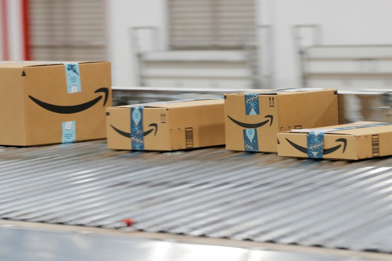 Amazon packages are transported by conveyor belts inside of an Amazon fulfillment center on Cyber Monday in Robbinsville, New Jersey
