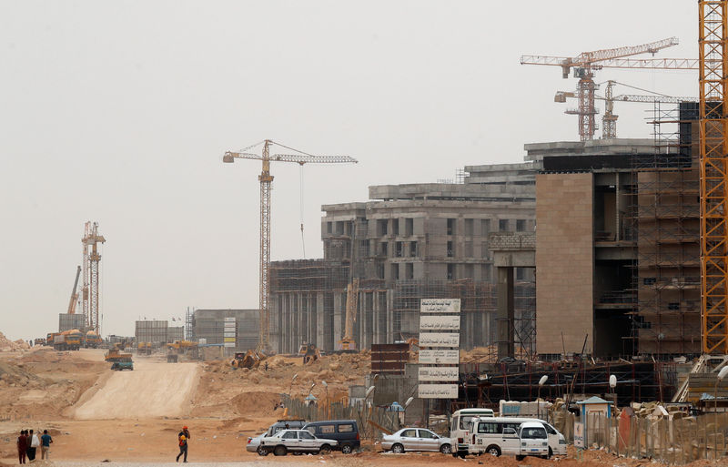 Construction machines and labourers work at the future headquarters of the Council of Ministers in the government district of the New Administrative Capital (NAC) east of Cairo