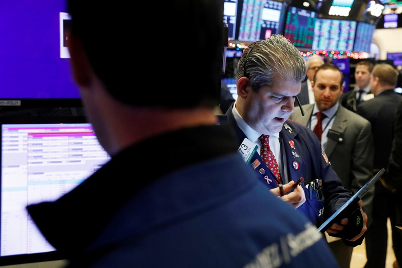 FILE PHOTO:  Traders work on the floor of the New York Stock Exchange shortly after the opening bell in New York