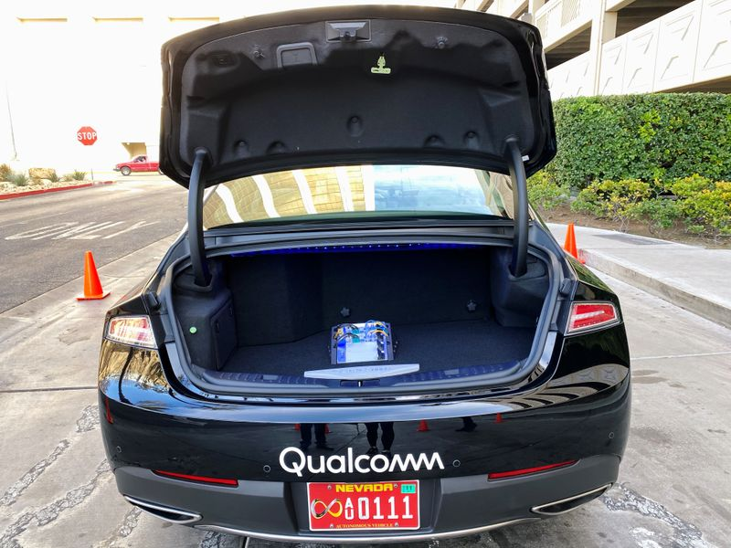 The new Snapdragon Ride autonomous driving computing system is seen in the trunk of a demo car at the Consumer Electronics Show in Las Vegas