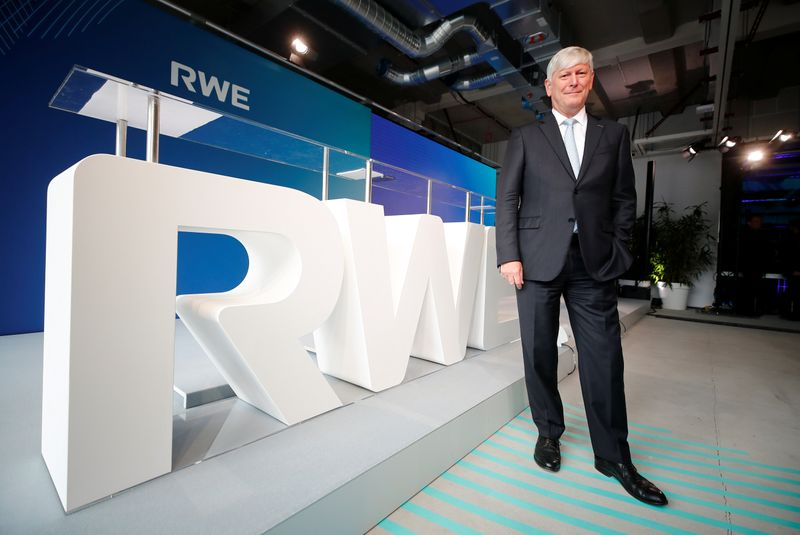 Rolf-Martin Schmitz, CEO of energy supplier RWE poses in front of a RWE logo following a news conference in Essen