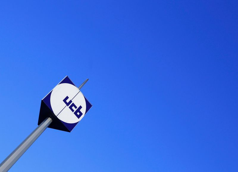 The logo of Belgian drug, chemical, and plastics group UCB is seen at the entrance of the company's headquarters in Brussels