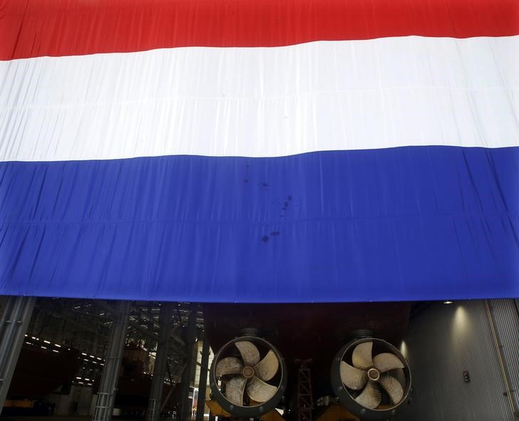 A national flag of Netherlands is seen near a constructing ship at Damen Song Cam Shipyard, a joint venture between Netherlands and Vietnam, in Hai Phong city
