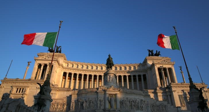 Italian flags waves at the Vittoriano monument in Rome