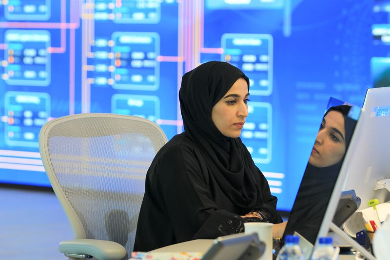 An employee is seen at the Panorama Digital Command Centre at the ADNOC headquarters in Abu Dhabi