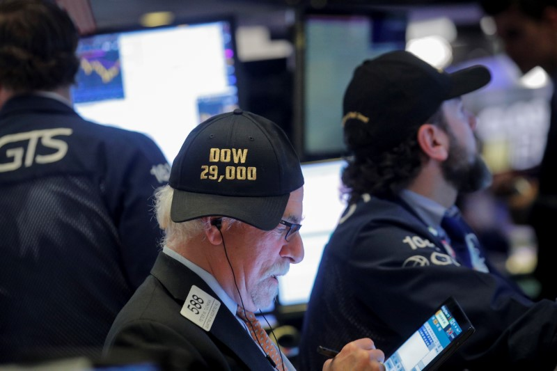 FILE PHOTO: Trader Peter Tuchman wears a DOW 29,000 hat on the floor at the NYSE in New York