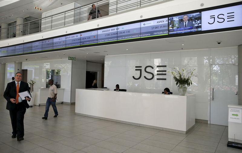 People walk near the reception at the Johannesburg Stock Exchange in Sandton, Johannesburg