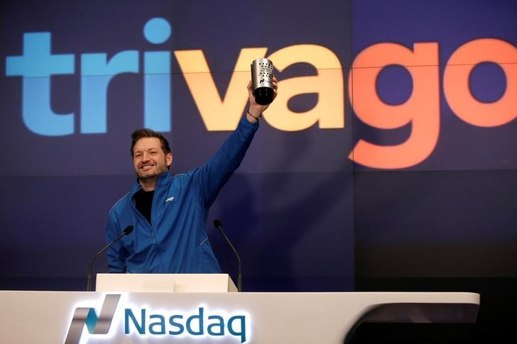 Trivago co-founder and CEO Rolf Schromgens celebrates before ringing the opening bell on the Nasdaq  Stock Market as Trivago, the hotel search platform, was listed during an initial public offering in New York