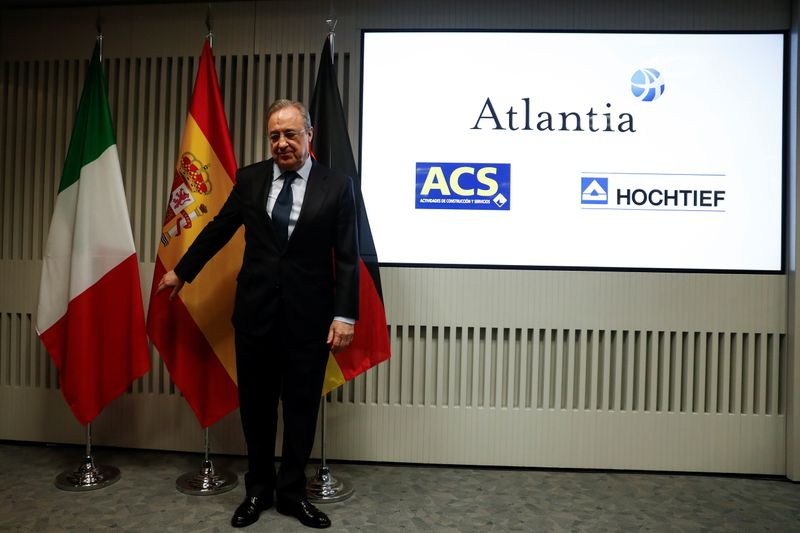 Perez, chairman of Spanish builder ACS, stands before a news conference in Madrid