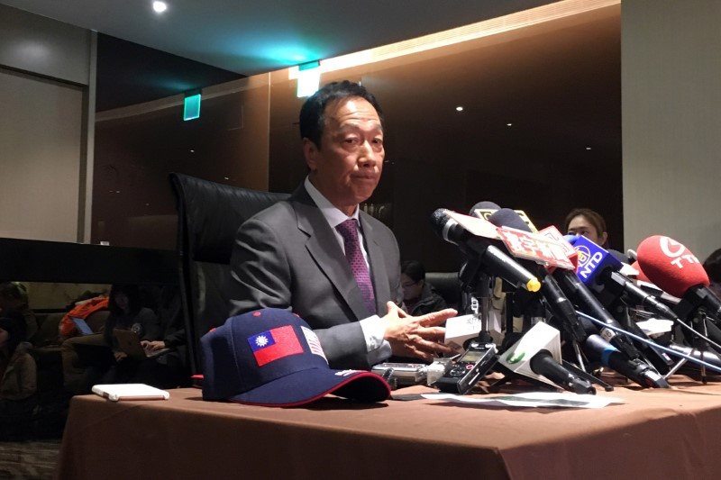 FILE PHOTO: Foxconn Technology Group founder Terry Gou attends a news conference before leaving for the United States, at Taipei Songshan Airport