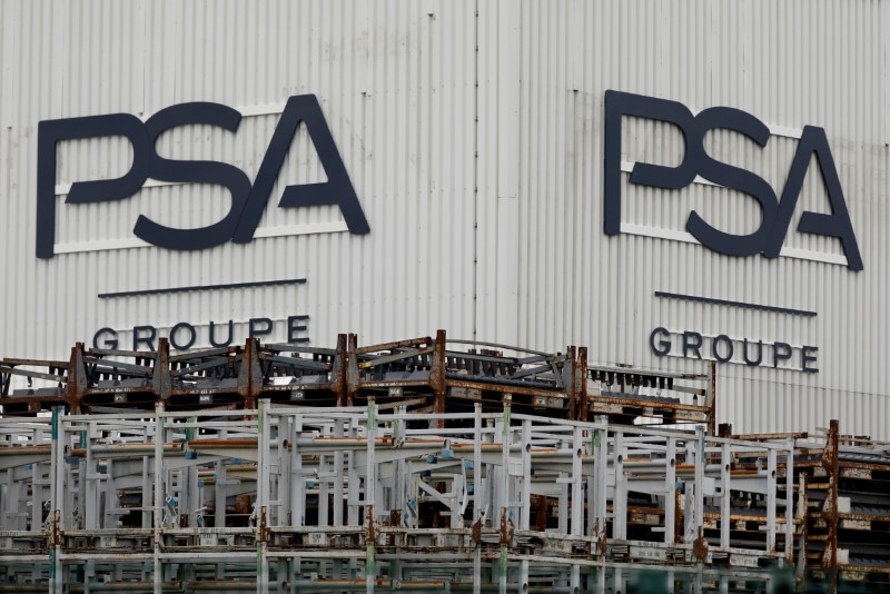 The logo of PSA Peugeot Citroen is seen at the company's plant in Poissy, near Paris