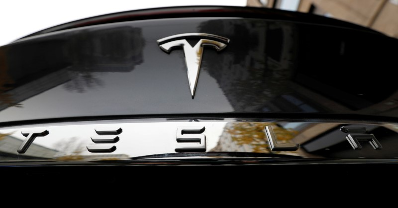 FILE PHOTO: The company logo is pictured on a Tesla Model X electric car in Berlin
