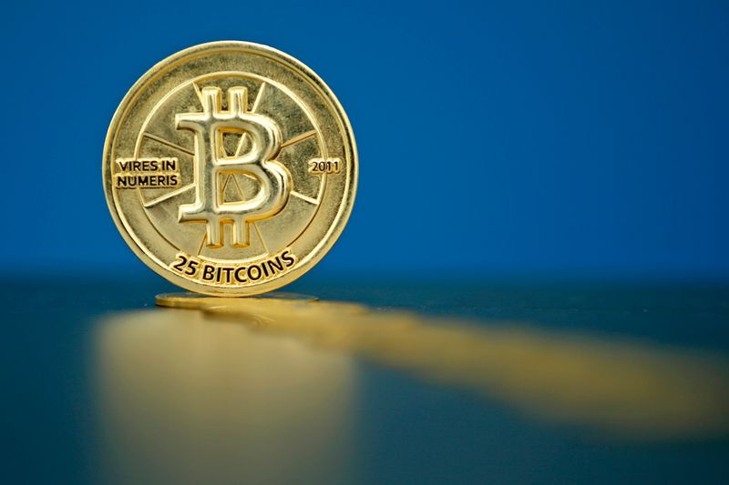 An illustration photo of Bitcoin (virtual currency) coins are seen at La Maison du Bitcoin in Paris
