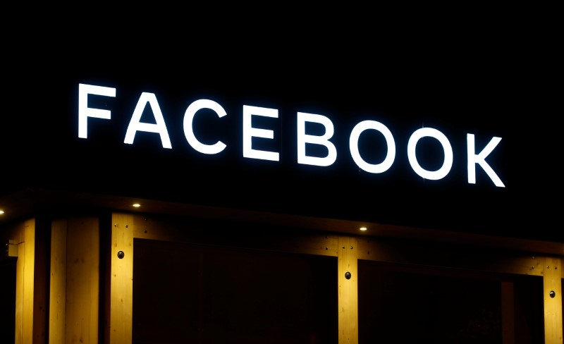 Logo of Facebook is seen in Davos