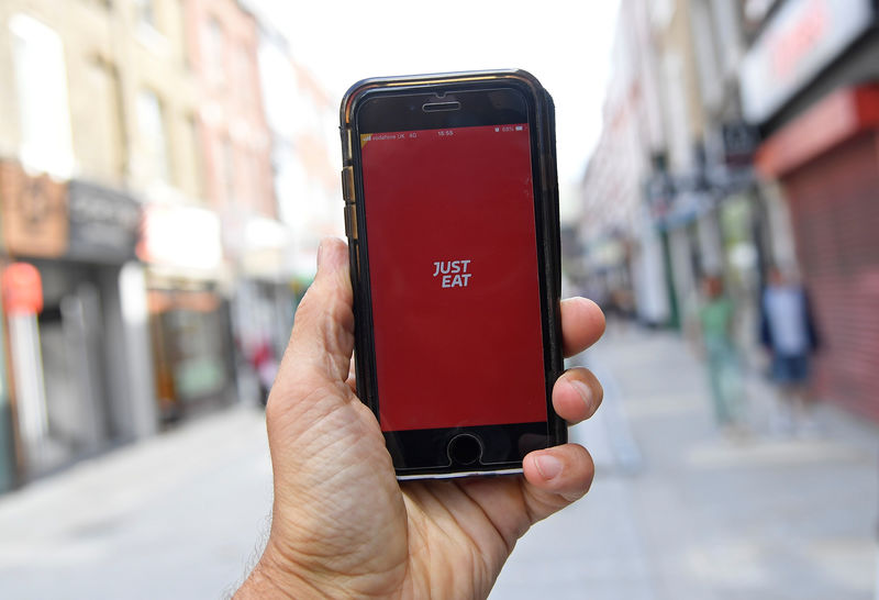 FILE PHOTO: The app for Just Eat is displayed on a smartphone, in London