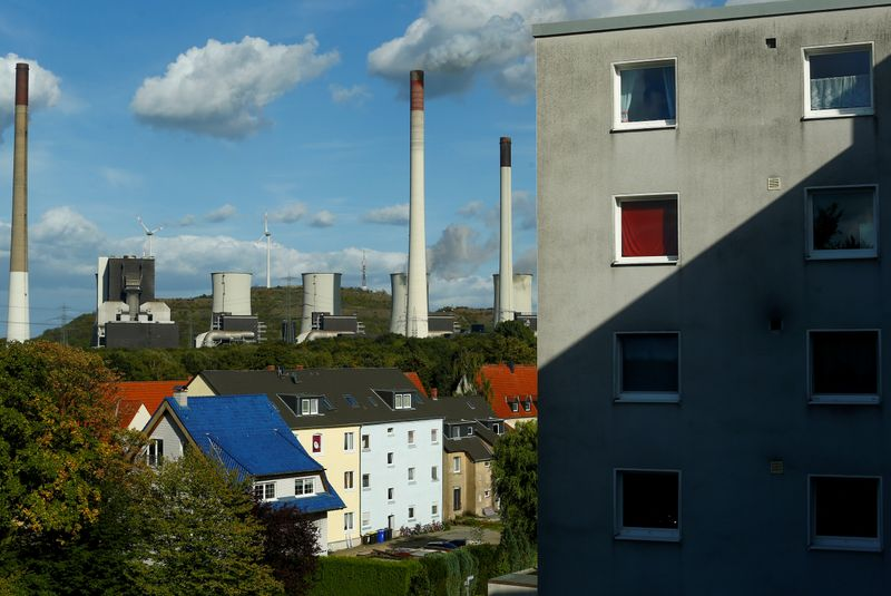 FILE PHOTO: The coal power plant Scholven of German energy utility company Uniper is seen behind houses in Gelsenkirchen