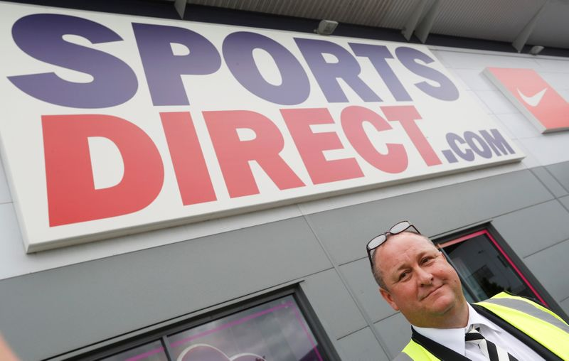 FILE PHOTO: Mike Ashley, founder and majority shareholder of sportwear retailer Sports Direct, leads journalists on a factory tour after the company's AGM, at the company's headquarters in Shirebrook