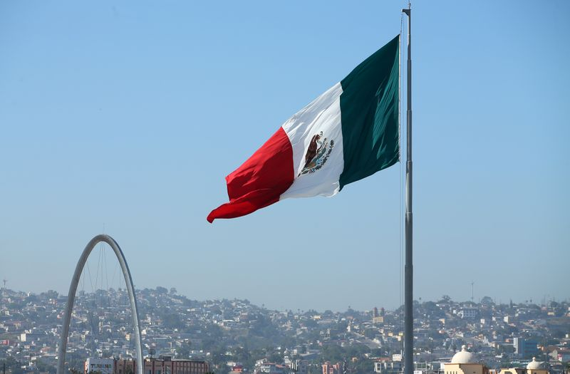 A Mexican flag is seen over the city of Tijuana, Mexico from San Ysidro, California