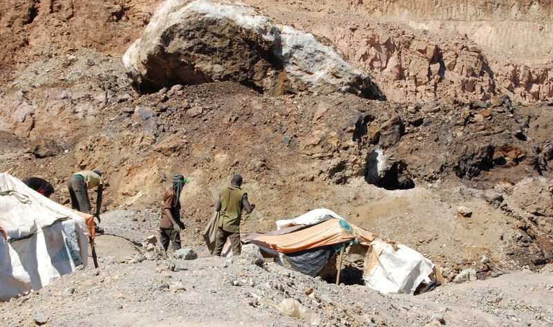 FILE PHOTO: Artisanal miners work at the Tilwizembe, a former industrial copper-cobalt mine, outside of Kolwezi, the capital city of Lualaba Province in the south of the Democratic Republic of the Congo