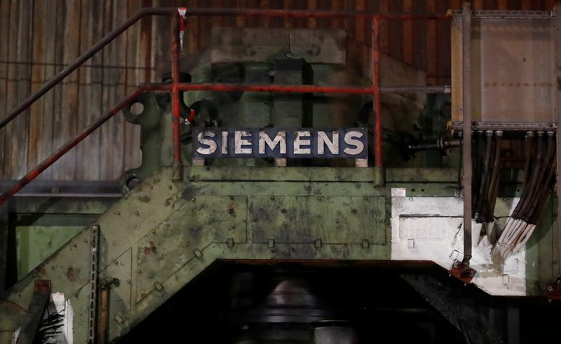 A sign of Germany's industrial group Siemens AG is pictured at a primary rolling mill of Germany's largest steel factory of ThyssenKrupp Steel AG in Duisburg