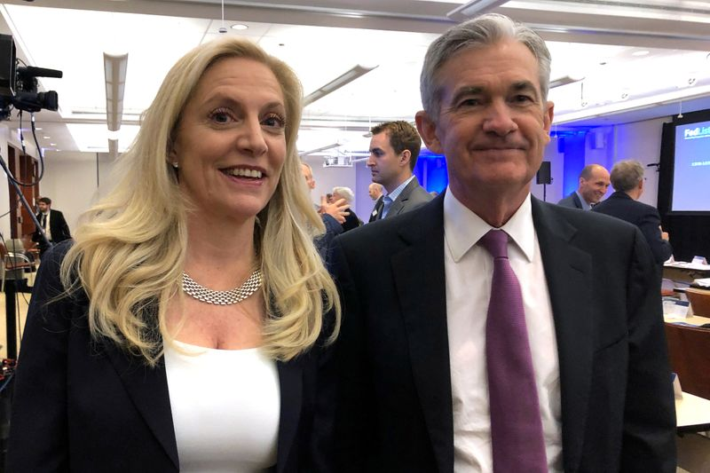 FILE PHOTO: Federal Reserve Chairman Jerome Powell poses for photos with Fed Governor Lael Brainard at the Federal Reserve Bank of Chicago