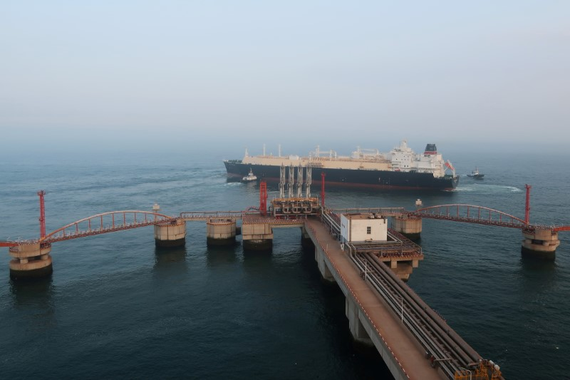 FILE PHOTO: A liquified natural gas (LNG) tanker is pictured near a terminal in Dalian, China