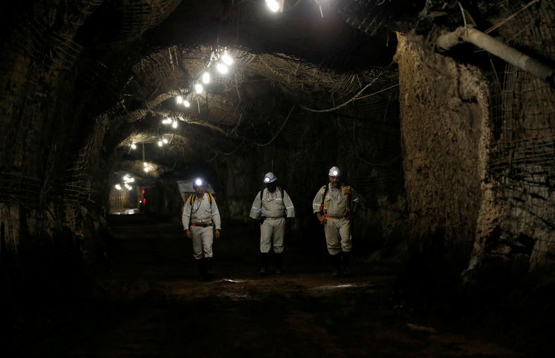 FILE PHOTO: Workers are seen underground South Africa's Gold Fields South Deep mine in Westonaria