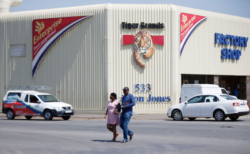 A couple leaves Tiger Brands factory shop in Germiston, Johannesburg