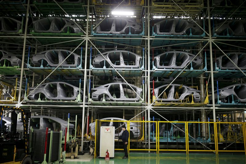 FILE PHOTO : A worker stands in front of parts of Hyundai Motor's sedans at its plant in Asan