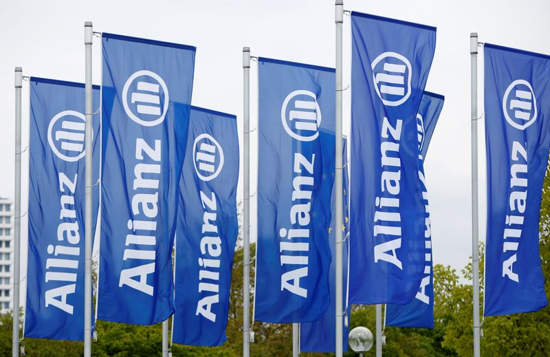 Flags with the logo of Allianz SE, Europe's biggest insurer, are pictured before the company's annual shareholders' meeting in Munich