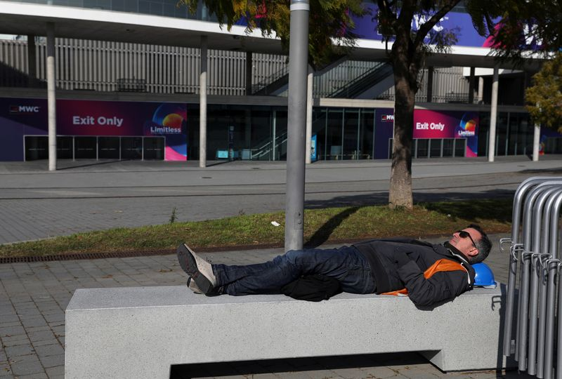 Employee rests at Fira de Barcelona after the Mobile World Congress (MWC) was cancelled, in Barcelona