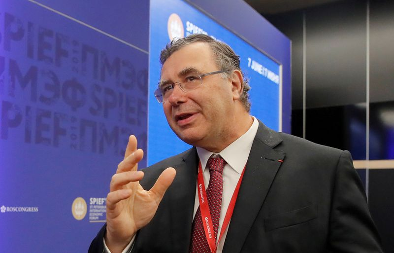 FILE PHOTO: Total CEO Pouyanne attends the St. Petersburg International Economic Forum