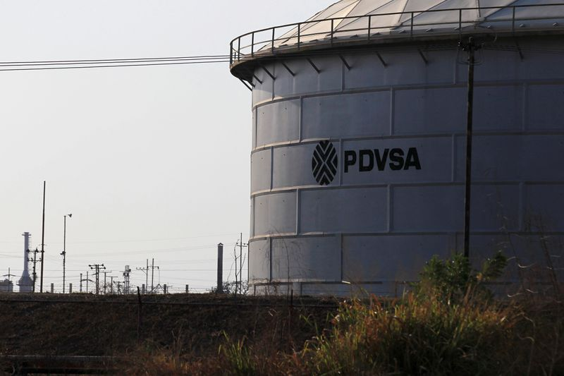 The corporate logo of state oil company PDVSA is seen on a tank at an oil facility in Lagunillas