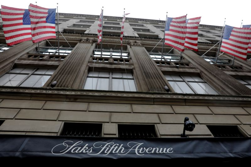 U.S. flags fly outside of Saks Fifth Avenue in New York