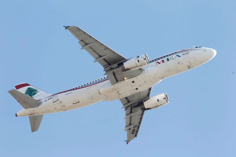 FILE PHOTO: A Lebanese Middle East Airlines (MEA) Airbus A320 plane flies over Beirut