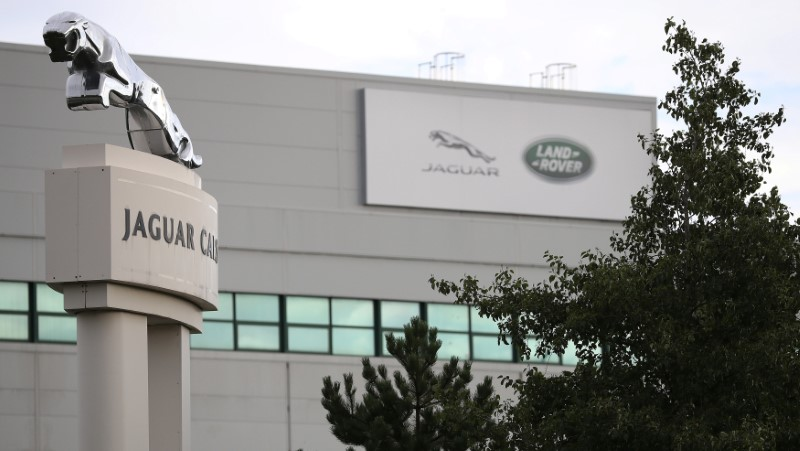 FILE PHOTO: Signs are seen outside the Jaguar Land Rover plant at Halewood in Liverpool, northern England.