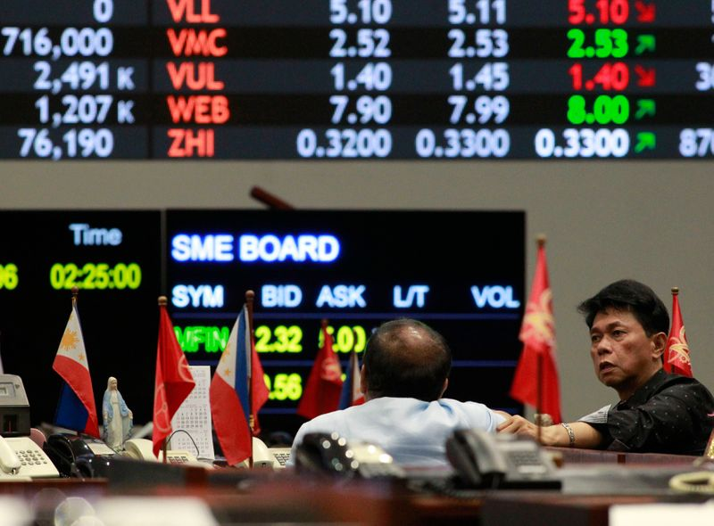 Stock brokers monitor trading at the Philippine Stock Exchange in Manila