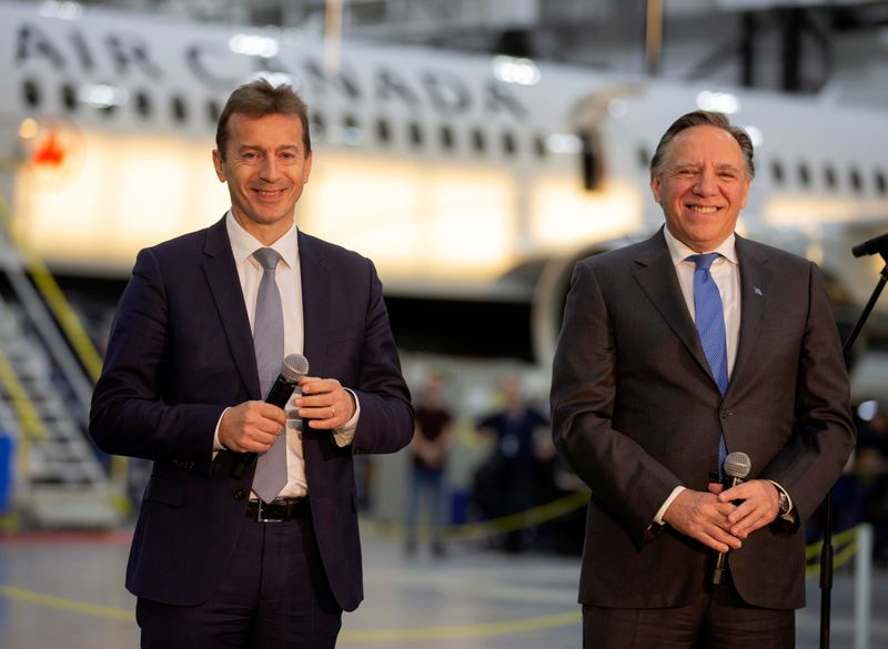 Airbus chief executive Guillaume Faury and Quebec Premier Francois Legault speak with reporters in Mirabel