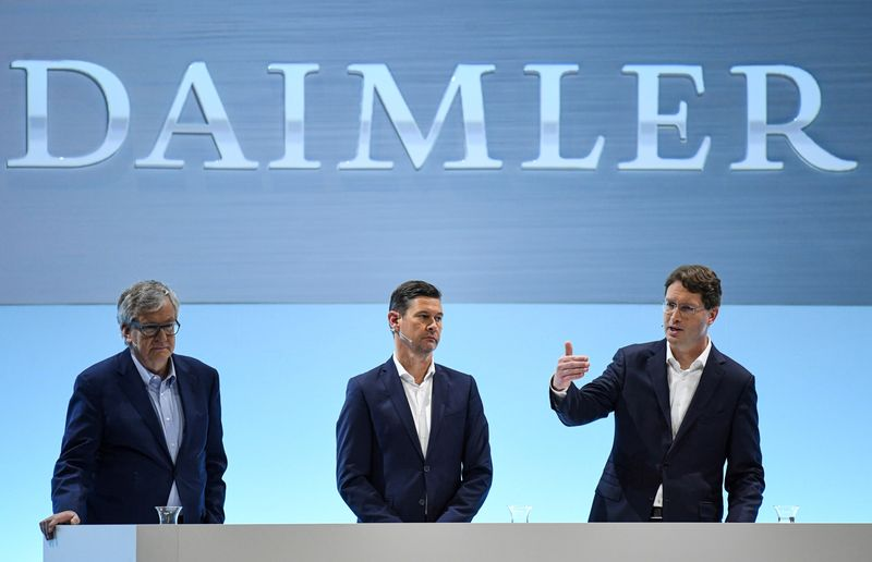 FILE PHOTO: Ola Kaellenius, CEO of German luxury car manufacturer Daimler AG, gestures next to CFO Harald Wilhelm and Martin Daum, head of Daimler Trucks and Buses
