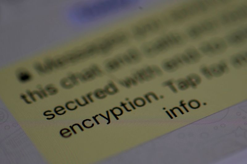 FILE PHOTO: An encryption message is seen on the  WhatsApp application on an iPhone i