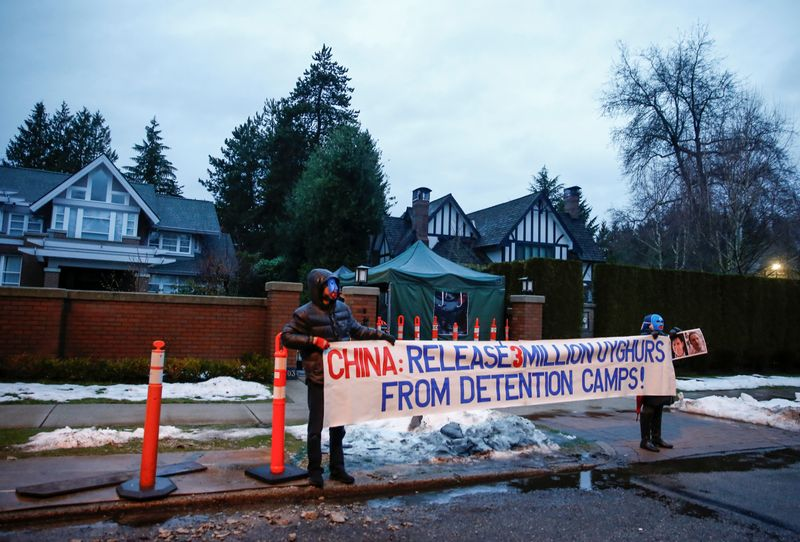People protest against the Uighur camps in China outside the home of Huawei Chief Financial Officer Meng Wanzhou before her extradition hearing in Vancouver
