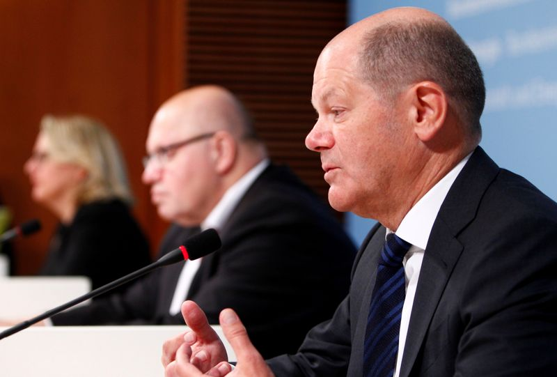 FILE PHOTO: Germany's Economy and Energy Minister Altmaier, Environment Minister Schulze and Finance Minister Scholz hold a news conference in Berlin