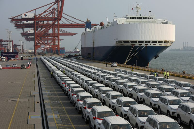 Imported Toyota cars arrive from a cargo vessel at the Shenzhen Dachan Bay Terminals in Guangdong